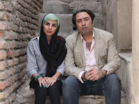 In this undated photo made available by International Campaign for Human Rights in Iran, Iranian poets Fatemeh Ekhtesari , left, and Mehdi Mousavi pose in unknown place in Iran. Two Iranian poets known for prose probing modern life face years in prison for their work and 99 lashes apiece for shaking hands with members of the opposite sex, the latest targets of a crackdown on expression in the Islamic Republic. (International Campaign for Human Rights in Iran via AP)