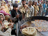 Pakistani poor people get free food from a restaurant in Rawalpindi, Pakistan on Monday, April 7, 2008. According to the World Food Programme (WFP) survey nearly half of Pakistan s 160 million people are at the risk of facing food shortage due to an increase in food prices. The WFP survey shows that the number of people who are  food insecure  has risen 28 percent to 77 million from 60 million last year. (AP Photo/Anjum Naveed)