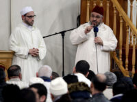 FILE - In this Friday, Nov. 20, 2015 file photo, Imam Mustafa Kastit, left, and President of the League of Imams in Belgium, Mohammed Tojgani, right, speak after leading prayer at the al-Khalil mosque in Molenbeek, Belgium. (AP Photo/Francois Walschaerts, File)