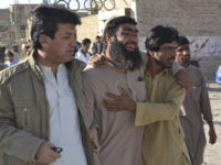 Pakistani family members of victims visit a police training center in Quetta, Pakistan, on Tuesday, after gunmen opened fire and detonated explosive vests in an hourslong siege of the academy. Scores of people were killed, mostly young police cadets.