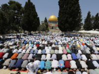 The Dome of Rock is seen in the background as Palestinian men pray on the compound known to Muslims as Noble Sanctuary and to Jews as Temple Mount in Jerusalem's Old City, on the first Friday of the holy month of Ramadan July 12, 2013. Israeli police said that Palestinian males over the age of 40 would be freely permitted to enter the compound in Jerusalem's Old City on Friday. REUTERS/Ammar Awad (JERUSALEM - Tags: RELIGION)