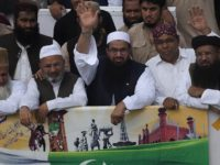 Hafiz Saeed, center, head of a religous group Jamaat-ud-Dawa waves to supporters while he with other leaders leads a rally to mark Pakistan Independence Day in Karachi, Pakistan on Sunday, Aug. 14, 2016. The Pakistani nation is celebrating its 70th Independence Day, to mark its independence from the British rule in 1947. (AP Photo/Shakil Adil)