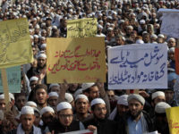 """Pakistani students of Islamic seminaries take part in a rally in support of blasphemy laws, in Islamabad, Pakistan, Wednesday, March 8, 2017. Hundreds of students rallied in the Pakistani capital, Islamabad, urging government to remove blasphemous content from social media and take stern action against those who posted blasphemous content on social media. The placard, center, in Urdu reads, """"Authorized Institutions immediately take action on the incidents of blasphemy and remove blasphemous content on social media."""" (AP Photo/Anjum Naveed)"""