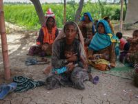 Muradi hold her eighteenth child as she wait for a checkup at the mobile clinic set up at Sikandarabad, district Naseerabad in Balochistan province, Pakistan