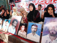 Px31-019 QUETTA: Dec31 – Children of missing persons stage a sit in demo demanding release of their fathers outside Quetta Press Club. ONLINE PHOTO by Naseer Ahmad Kakar