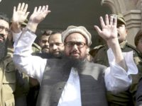 Lahore : Hafiz Saeed, head of the Pakistani religious party, Jamaat-ud-Dawa, waves on his arrival to a court in Lahore, Pakistan, Tuesday, Nov. 21, 2017. The U.S. has offered a $10 million bounty for Saeed and the U.N. Security Council labeled his party a terrorist front group in 2008. AP/PTI(AP11_21_2017_000059B)