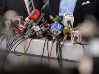 "In this picture taken on June 28, 2018, microphones of the different Pakistani news channels are placed at a desk before a press conference outside the Supreme Court building, in Islamabad. Facing abductions, censorship and financial ruin, journalists in Pakistan say they are under unprecedented pressure to bend to authorities' will as the country heads to nationwide polls, sparking allegations that the military is overseeing a ""silent coup"". / AFP PHOTO / AAMIR QURESHI / TO GO WITH: Pakistan-media-elections-military, FOCUS by David STOUT"