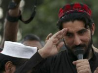 epa06686477 Manzoor Pashteen (R), leader of Pashtun Tahafuz Movement (PTM) speaks to supporters during a gathering in Lahore, Pakistan, 22 April 2018 (issued 23 April). Thousands of supporters of PTM gathered in Lahore demanding the government to produce missing persons who were allegedly taken by the intelligence agencies on pretext of fighting terrorism.  EPA-EFE/RAHAT DAR