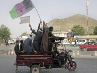 Kabul: Taliban fighters and their supporters carry a representation of the Afghan national flag and a Taliban flag while riding in a motorized vehicle, in Kabul, Afghanistan, Sunday, June 17, 2018. A suicide bomber struck Sunday in Afghanistan's eastern city of Jalalabad, killing at least 18 people in the second attack in as many days targeting Taliban fighters, security forces and civilians celebrating a holiday cease-fire. AP/PTI(AP6_17_2018_000142B)